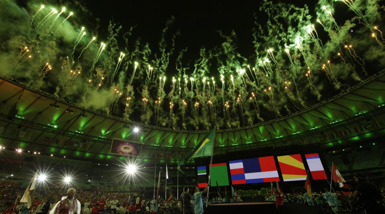 A Brazilian athlete holds her countries flag during the closing ceremony of the Rio 2016 Paralympic Games at the Maracana Stadium in Rio de Janeiro, Brazil, Sunday, Sept. 18, 2016. (AP Photo/Leo Correa)