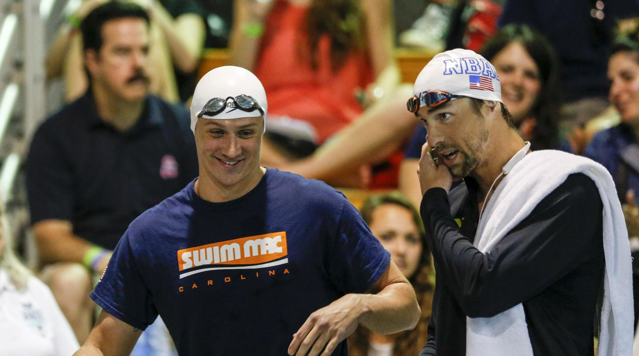 A May 15, 2015, file photo, Ryan Lochte, left, and Michael Phelps talk before the start of the 100-meter butterfly final at the Arena Pro Swim Series meet in Charlotte, N.C. Add Phelps' name to the list of Americans who were less than amused by teammate L