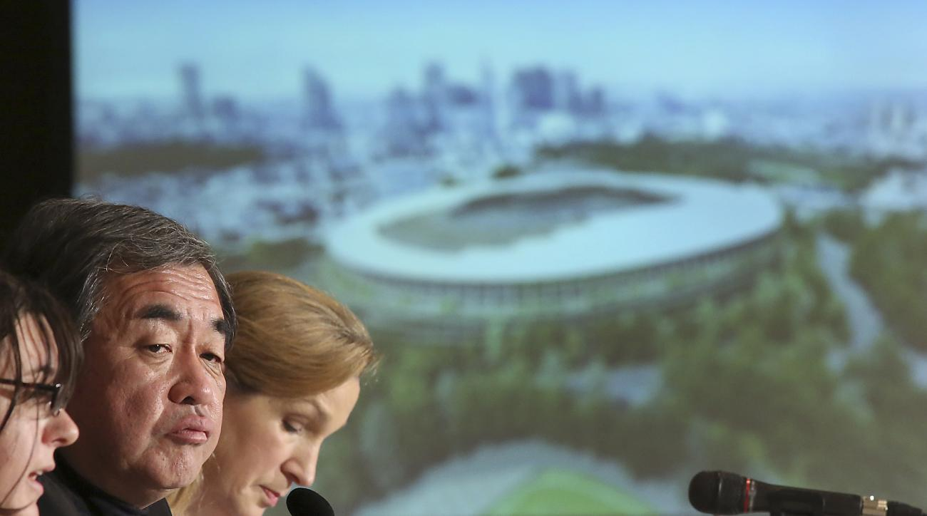 FILE - In this Jan. 15, 2016 file photo, Japanese architect Kengo Kuma, second left, speaks about his design of the 2020 Tokyo Olympic stadium during a press conference in Tokyo.  A Tokyo government panel is set to propose moving more venues outside of th