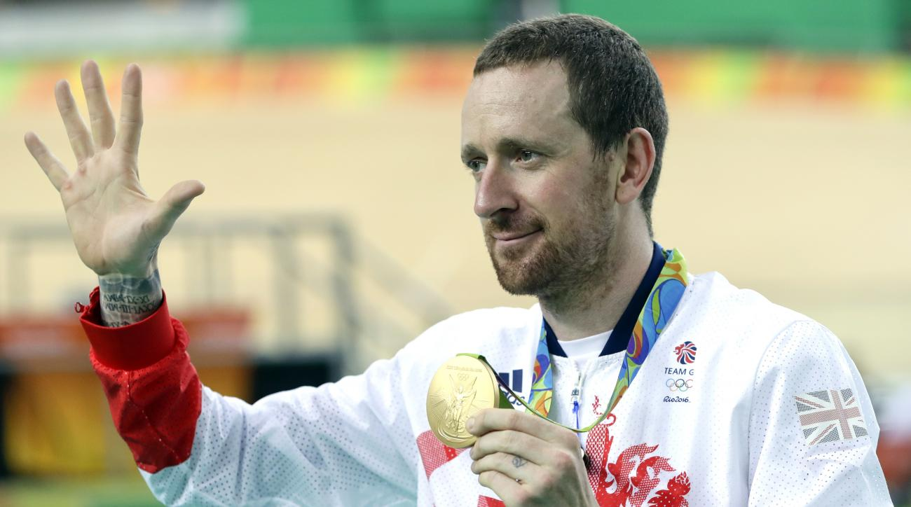 FILE - This is a Friday, Aug. 12, 2016 file photo of Gold medalist Bradley Wiggins of Britain as he poses on the podium of the Men's team pursuit final at the Rio Olympic Velodrome during the 2016 Summer Olympics in Rio de Janeiro, Brazil. Somewhere in Ru