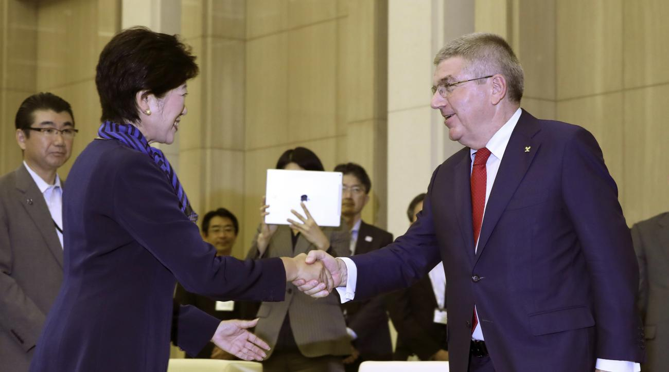 International Olympic Committee President Thomas Bach, right, is welcomed by Tokyo Gov. Yuriko Koike, front left, during a meeting at the Tokyo Metropolitan government building in Tokyo, Tuesday, Oct. 18, 2016. Bach arrived Tuesday in Japan amid growing t