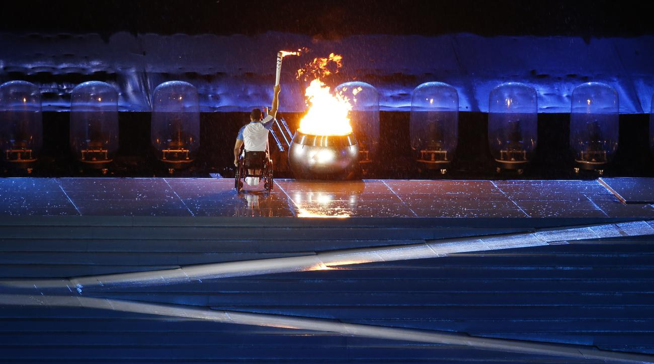 FILE - In this Sept. 7, 2016, file photo, Brazilian athlete Clodoaldo da Silva lights the olympic flame during the opening ceremony of the Rio 2016 Paralympic Games at Maracana Stadium in Rio de Janeiro, Brazil. The official Olympic broadcaster said Monda