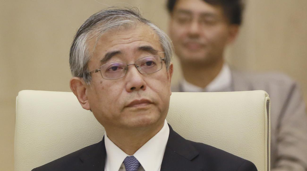 In this Tuesday, Nov. 1, 2016 photo, Shinichi Ueyama, special advisor for Tokyo Metropolitan Government on reform, listens during an expert panel at the city hall in Tokyo. The panel of academics and business consultants hand-picked by Tokyo Gov. Yuriko K