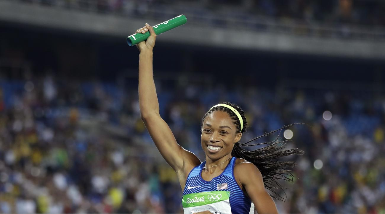 FILE - In this Aug. 20, 2016, file photo, United States' Allyson Felix celebrates after winning the gold medal in the women's 4x400-meter relay final during the athletics competitions of the 2016 Summer Olympics at the Olympic stadium in Rio de Janeiro, B