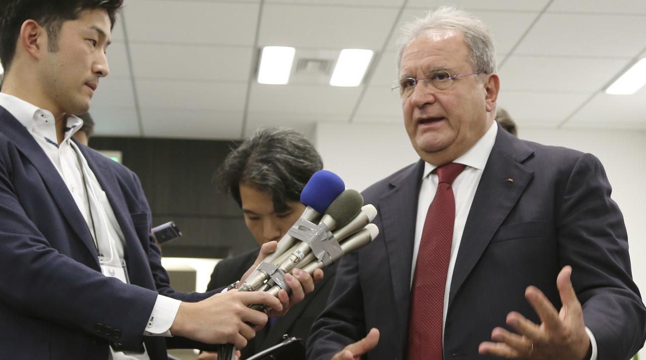 The president of the World Baseball Softball Confederation Ricardo Fraccari, right, speaks during a press conference in Tokyo, Friday, Nov. 18, 2016. (AP Photo/Koji Sasahara)