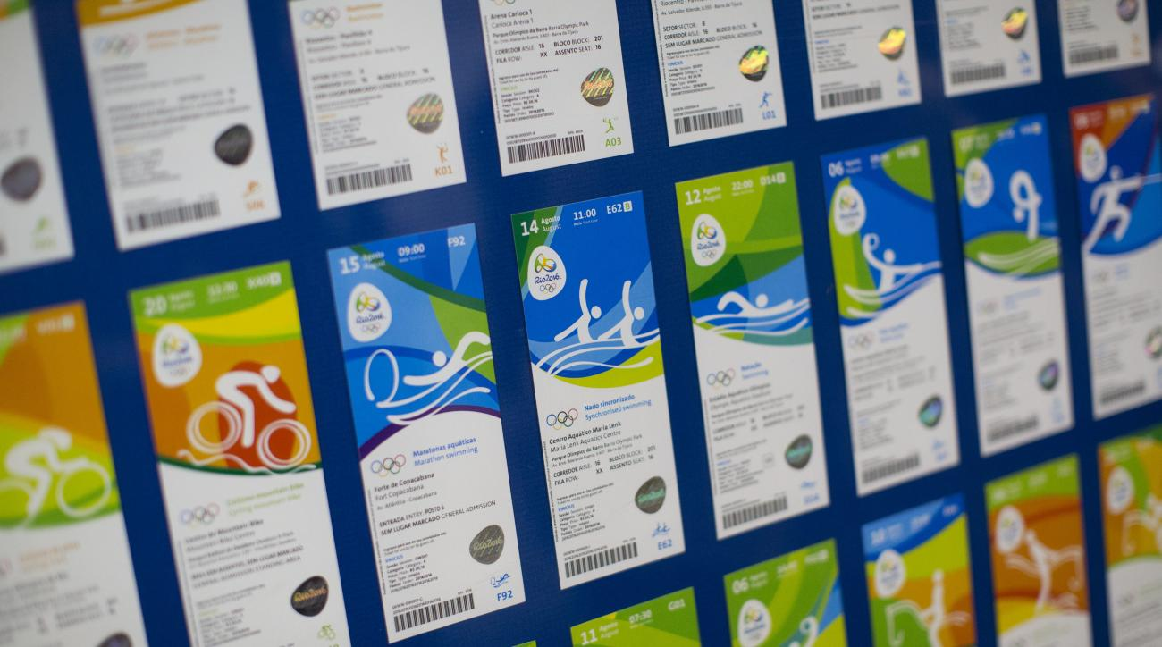FILE - This May 20, 2016 file photo shows the presentation of the new design of Olympic tickets at Rio Olympic headquarters in Rio de Janeiro, Brazil.  Olympic organizers say they want to return about $3 million in ticket refunds to people who returned th