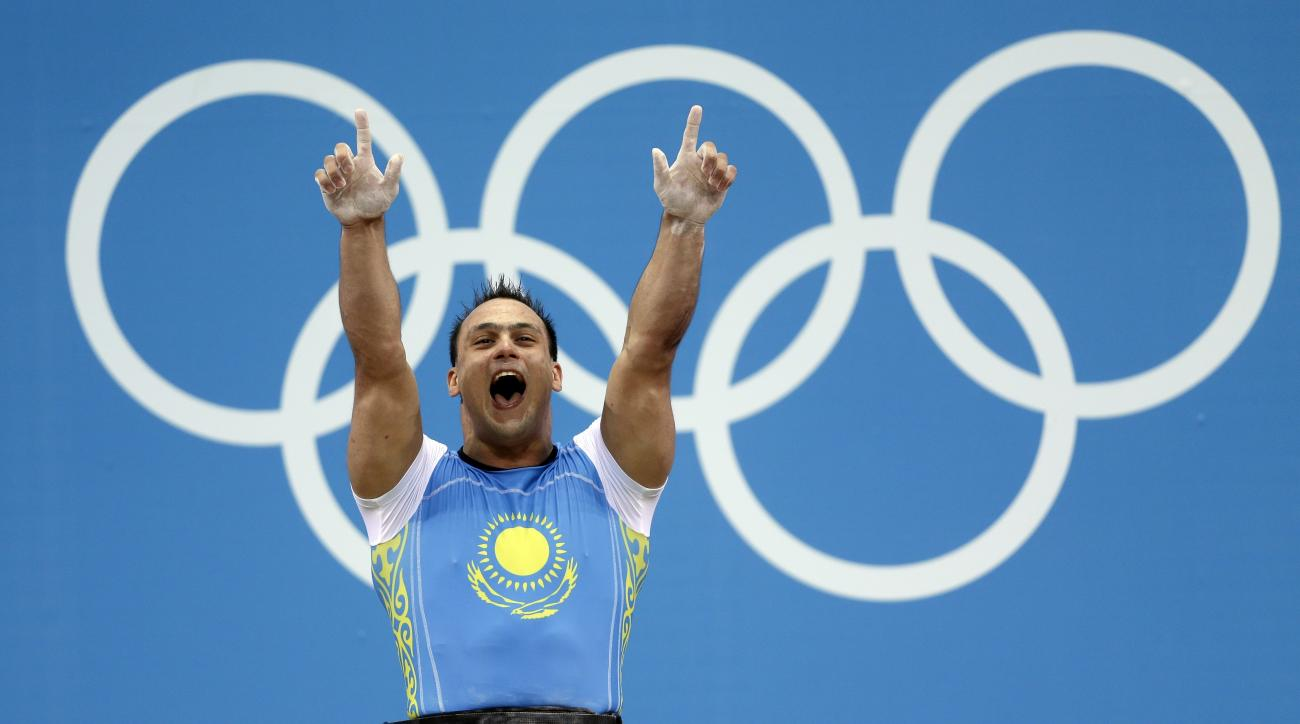 FILE- In this Saturday, Aug. 4, 2012 file photo Kazakhstan's Ilya Ilyin reacts after a world record 233-kg clean-and-jerk lift during the men's 94-kg, group A, weightlifting competition at the 2012 Summer Olympics in London. Kazakhstan said Wednesday, Nov
