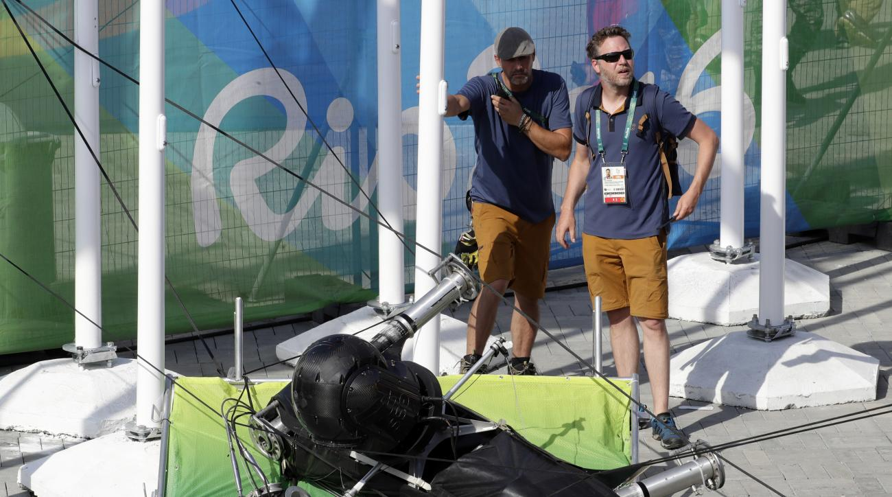 FILE - In this Aug. 15, 2016 file photo, an overhead camera that fell from wires suspending it over Olympic Park lays on the ground at the Summer Games in Rio de Janeiro, Brazil. A police investigation report released Friday, Nov. 25, 2016 says negligence