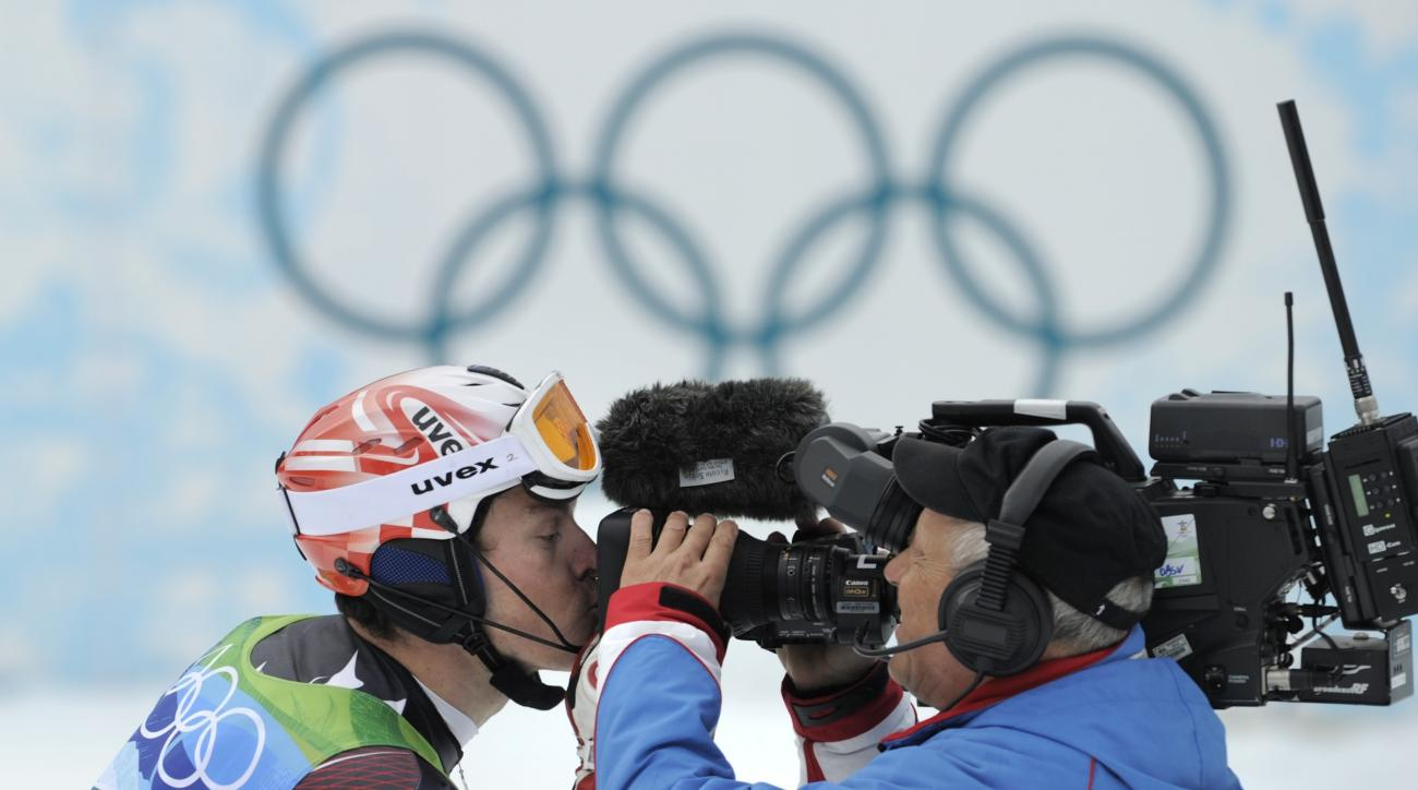 FILE - In this Feb. 27, 2010 file photo Croatia's Ivica Kostelic kisses a TV camera as he reacts after finishing the second run of the Men's slalom, at the Vancouver 2010 Olympics in Whistler, British Columbia. Eurosport will have exclusive broadcast righ
