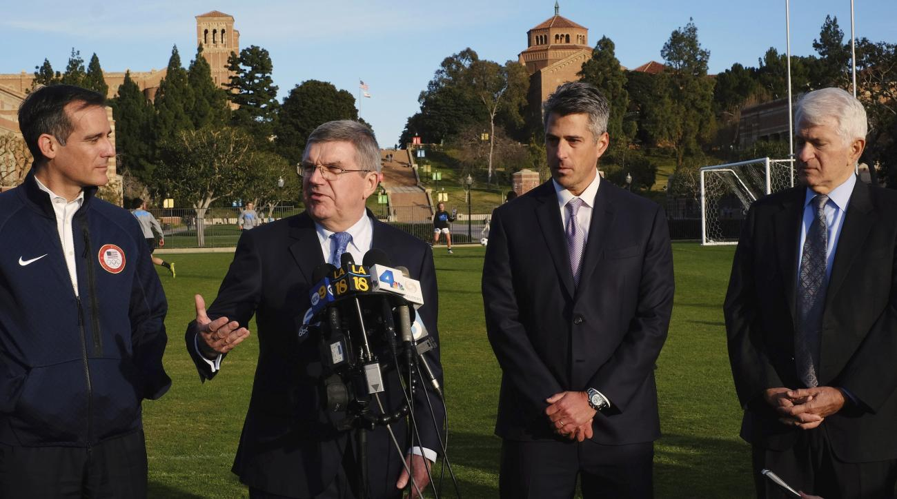 FILE - In this Feb. 1, 2016, file photo, International Olympic Committee President Thomas Bach, second from left, is flaked by Los Angeles Mayor Eric Garcetti, left, and LA 2024 chairman Casey Wasserman, second from right, and UCLA chancellor Gene Block,