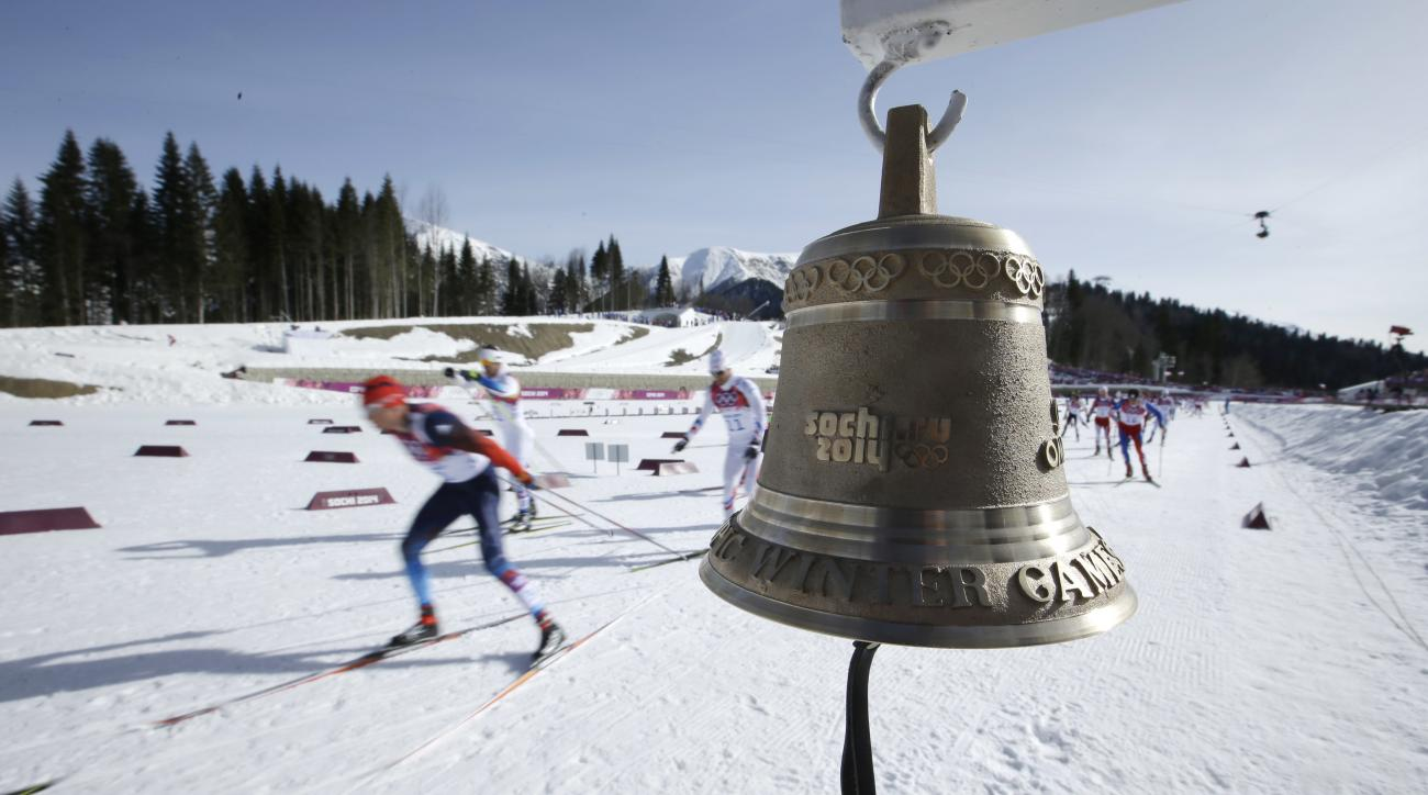 FILE In this Sunday, Feb. 23, 2014 file photo, athletes pass by the bell during the men's 50K cross-country race at the 2014 Winter Olympics in Krasnaya Polyana, Russia. Russias top cross-country skiing official said Thursday, Dec. 15, 2016 she is prepare