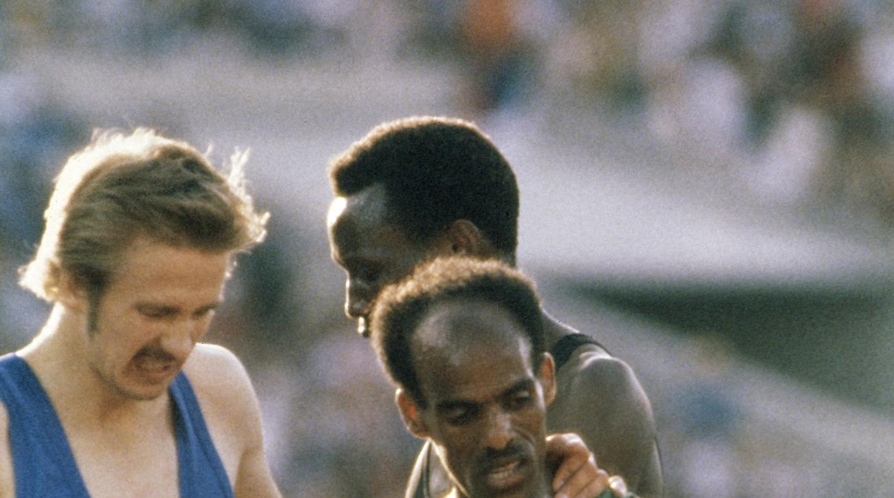 FILE - In this Friday, August 1, 1980 file photo Bronze medal winner Kaarlo Maaninka of Finland, left, congratulates Miruts Yifter who won the gold medal in the Men's 5,000 meter Race at the Summer Olympic Games in Moscow, Russia. Miruts Yifter, an Ethiop