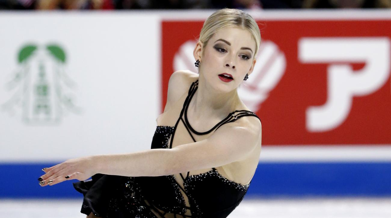 FILE - In this Friday, Oct. 21, 2016 file photo, Gracie Gold competes in women's short program at the Skate America figure skating event, in Hoffman Estates, Ill. American figure skater Gracie Gold says she never could have imagined the scope of Russian d