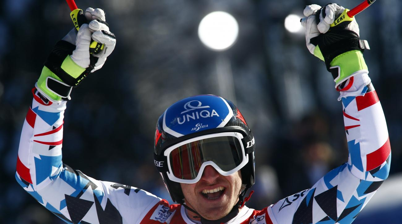 Austria's Matthias Mayer celebrates at the finish area of an alpine ski, men's World Cup Super G, in Kitzbuehel, Austria, Friday, Jan. 20, 2017. (AP Photo/Giovanni Auletta)