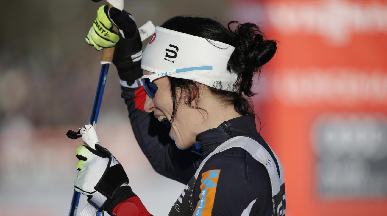 Marit Bjergen Norway celebrates after winning the women's 10km free style competition at the FIS Cross Country skiing World Cup event in Ulricehamn, Sweden, Saturday, Jan. 21, 2017. (Adam Ihse/TT News Agency via AP)
