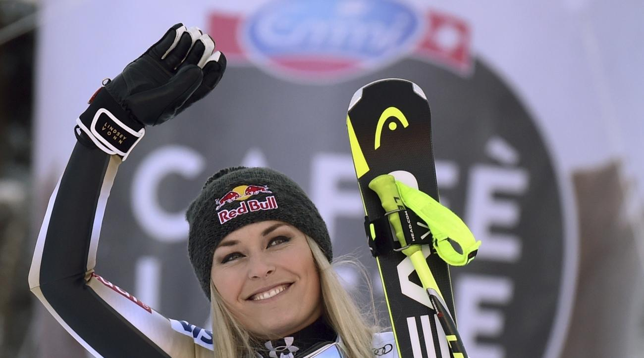 United States' Lindsey Vonn celebrates after winning an alpine ski, women's World Cup downhill, in Garmisch-Panterkirchen, Germany, Saturday, Jan. 21, 2017. (AP Photo/Marco Tacca)