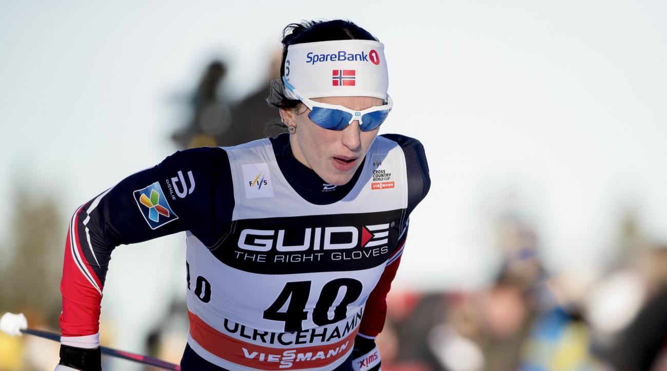 Marit Bjorgen of Norway competes to take the first place during the women's 10km free style competition at the FIS Cross Country skiing World Cup event in Ulricehamn, Sweden, Saturday, Jan. 21, 2017. (Adam Ihs/TT News Agency via AP)