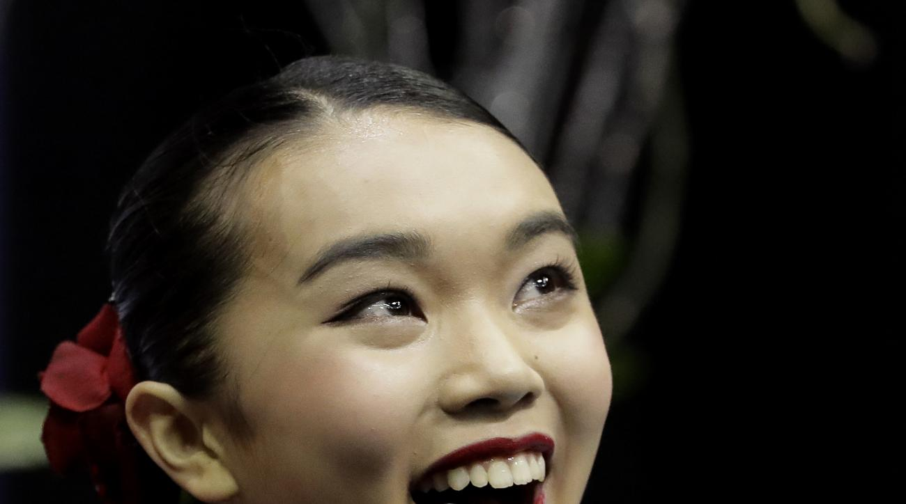 Karen Chen reacts as her score is announced during the women's free skate competition at the U.S. Figure Skating Championships, Saturday, Jan. 21, 2017, in Kansas City, Mo. (AP Photo/Charlie Riedel)
