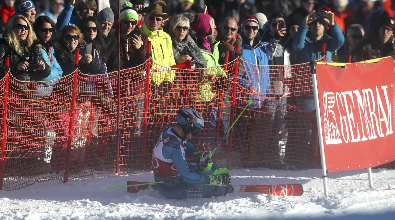 Norway's Henrik Kristoffersen lies in the snow after skiing off course during an alpine ski, men's World Cup slalom, in Kitzbuehel, Austria, Sunday, Jan. 22, 2017. (AP Photo/Shinichiro Tanaka)