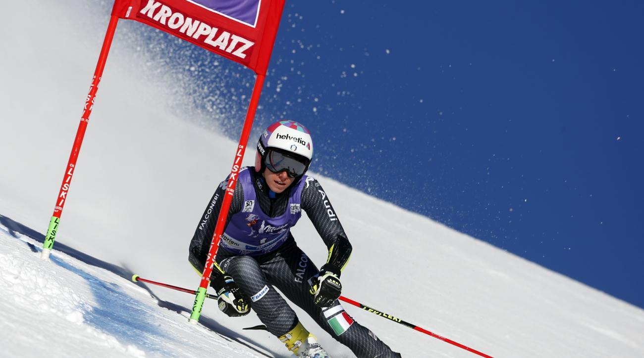 Italy's Marta Bassino speeds down the course during an alpine ski, women's World Cup giant slalom, in San Vigilio di Marebbe, Italy, Tuesday, Jan. 24, 2017. (AP Photo/Marco Trovati)