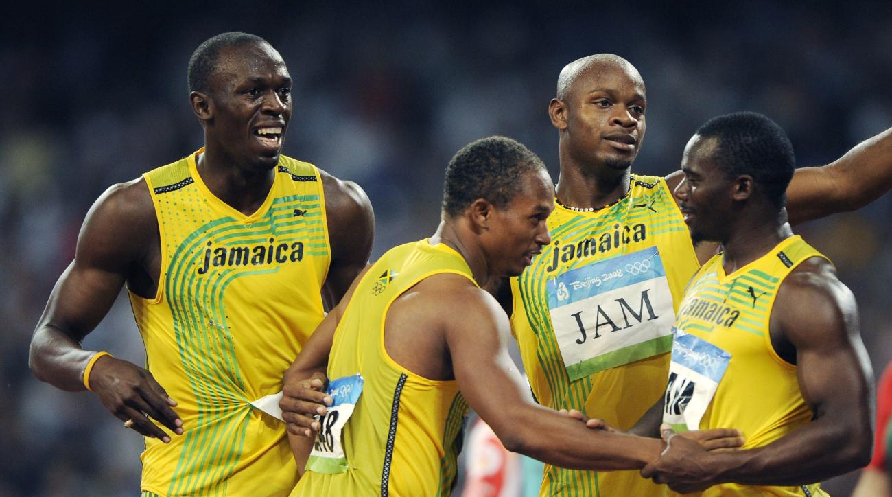 FILE - In this Friday, Aug. 22, 2008 file photo, Jamaica's gold medal winning relay team, from left, Usain Bolt, Michael Frater, Asafa Powell and Nesta Carter celebrate after the men's 4x100-meter relay final during the athletics competitions in the Natio