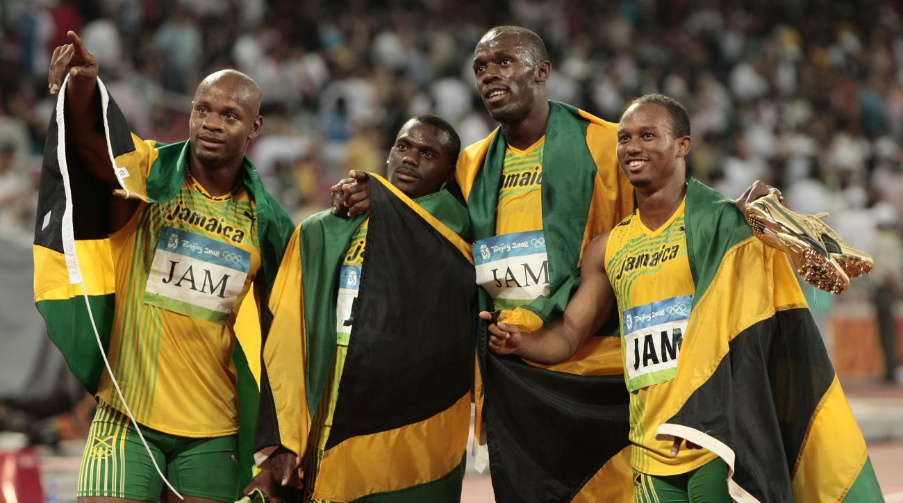 FILE - In this Friday, Aug. 22, 2008 file photo, Jamaica's gold medal winning relay team, Usain Bolt, 2nd right, Michael Frater, right, Asafa Powell, left, and Nesta Carter celebrate after the men's 4x100-meter relay final during the athletics competition