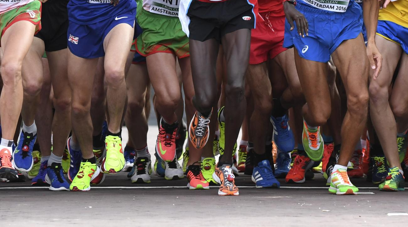 FILE - In this file photo dated Sunday, July 10, 2016, Athletes leave the half marathon start line during the European Athletics Championships in Amsterdam, the Netherlands. The European Athletic Association said in a statement Thursday Jan. 26, 2017, it