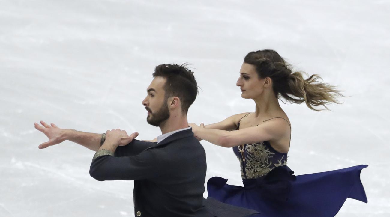 Gabriella Papadakis and Guillaume Cizeron, of France, skate their short dance at the Figure Skating European Championships in Ostrava, Czech Republic, on Thursday, Jan. 26, 2017. (AP Photo/Petr David Josek)