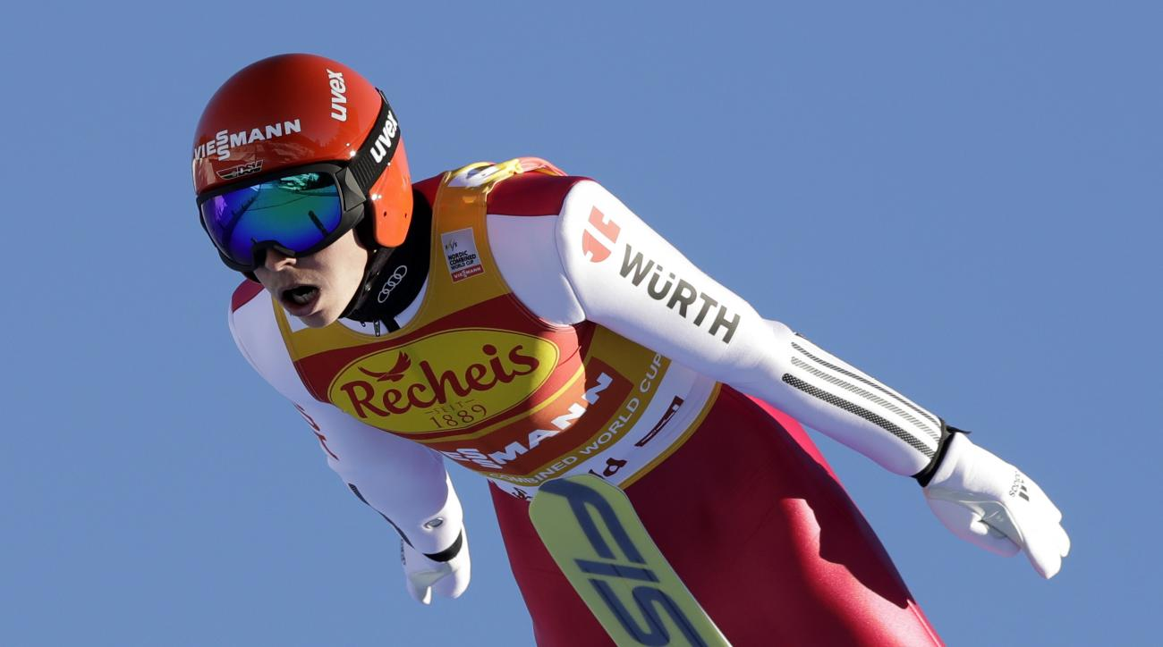 Eric Frenzel of Germany soars through the air during the Nordic Combined World Cup competition in Seefeld, Austria, Friday, Jan. 27, 2017. (AP Photo/Matthias Schrader)