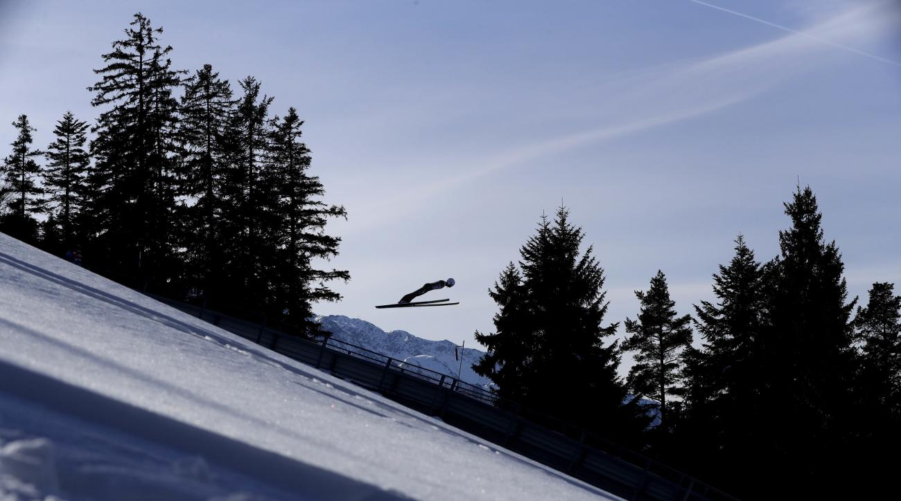 Samuel Costa of Italy soars through the air during the Nordic Combined World Cup competition in Seefeld, Austria, Saturday, Jan. 28, 2017. (AP Photo/Matthias Schrader)