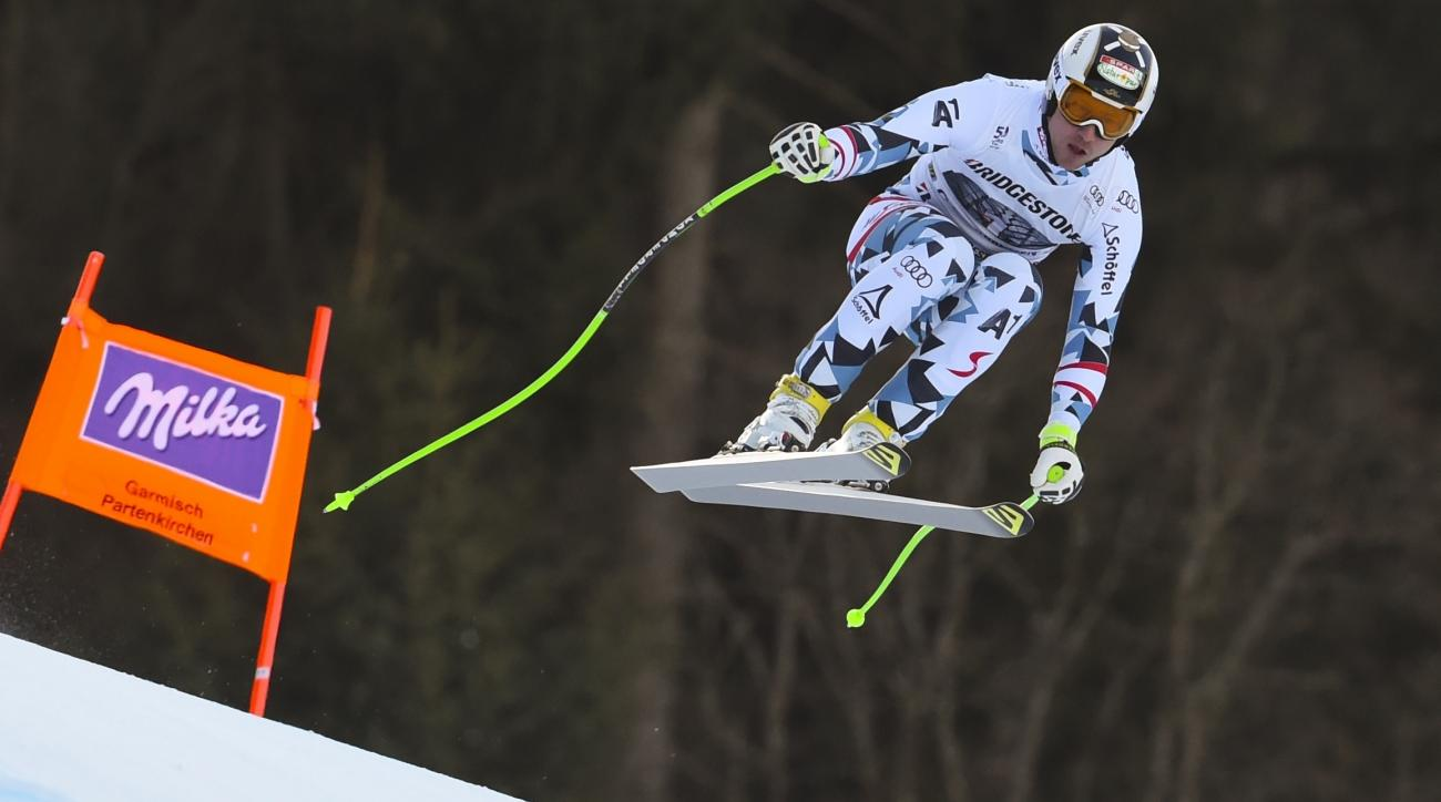 Austria's Hannes Reichelt takes a jump on his way to win an alpine ski, men's World Cup downhill race, in Garmisch-Panterkirchen, Germany, Sunday, Jan. 28, 2017. (AP Photo/Marco Tacca)
