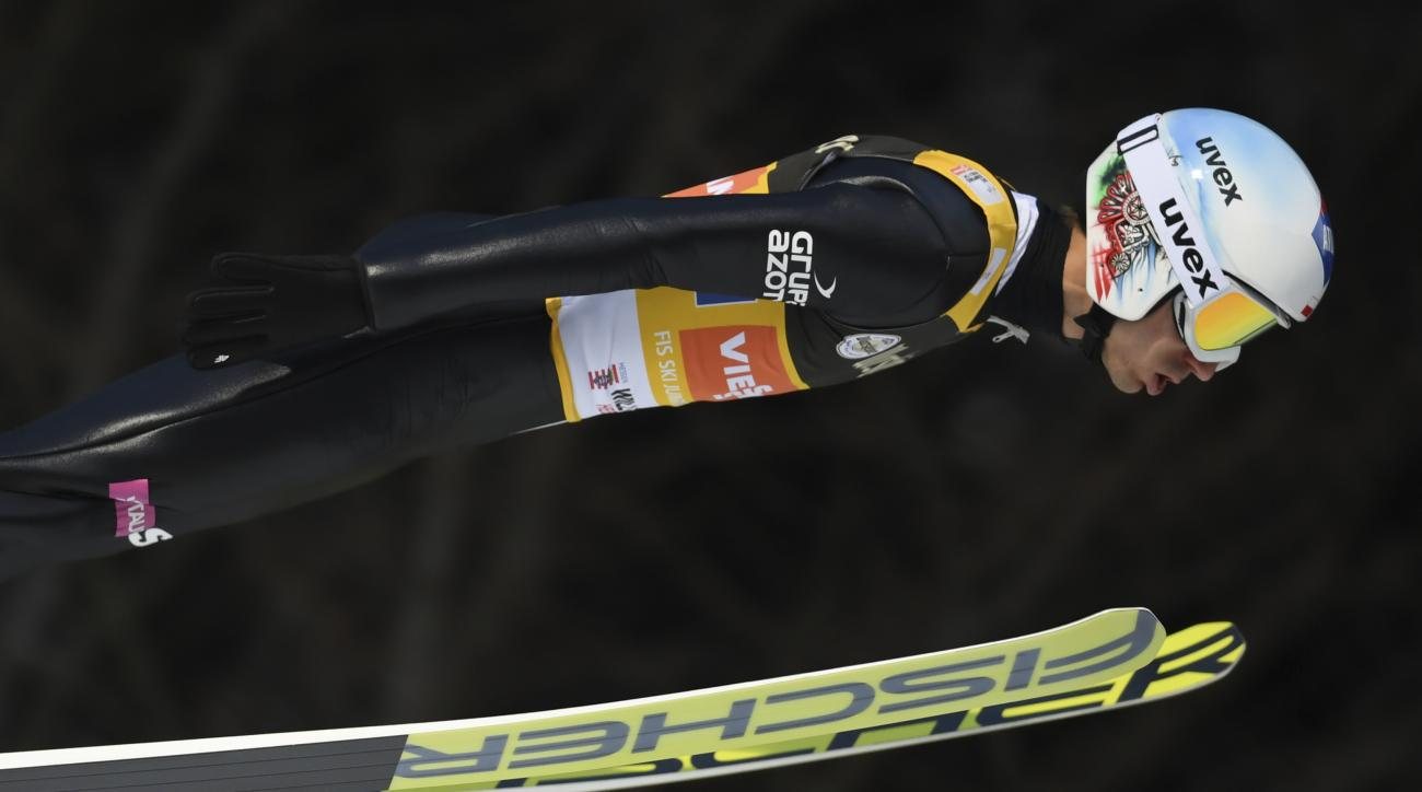 Poland's Kamil Stoch soars through the air during the ski jumping team World Cup in Willingen, Germany, Saturday, Jan. 28, 2017. (Arne Dedert/dpa via AP)