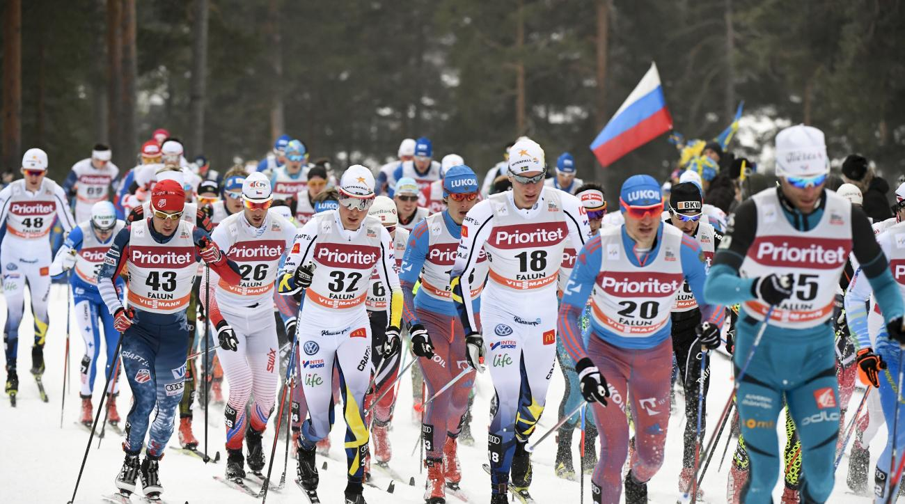 Skiers in action at the start of the mens 30km mass start event at the FIS Cross Country World Cup in Falun, Sweden, Sunday, Jan. 29, 2017. (Ulf Palm /TT via AP)