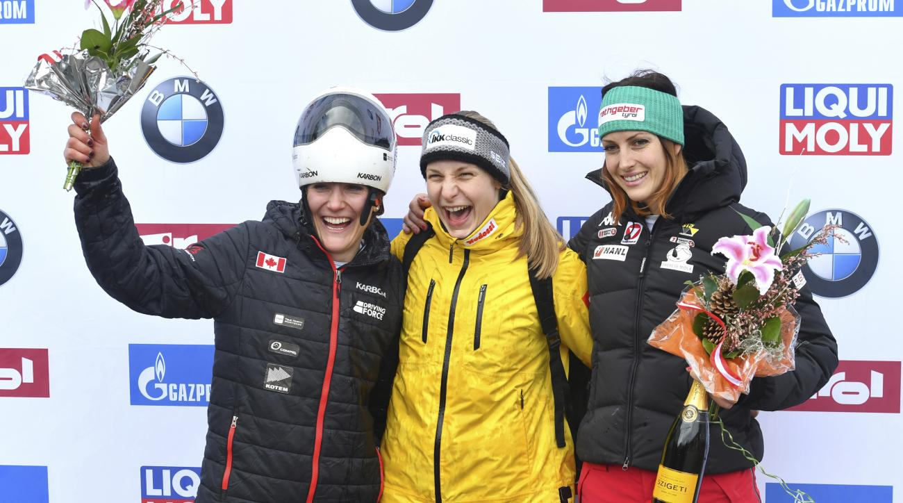 Germany's winner Tina Hermann, center, Canada's second placed Mirela Rahneva, left, and Austria's third placed Janine Flock pose for media after the women's Skeleton World Cup race in Igls, near Innsbruck, Austria, Friday, Feb. 3, 2017. (AP Photo/Kerstin
