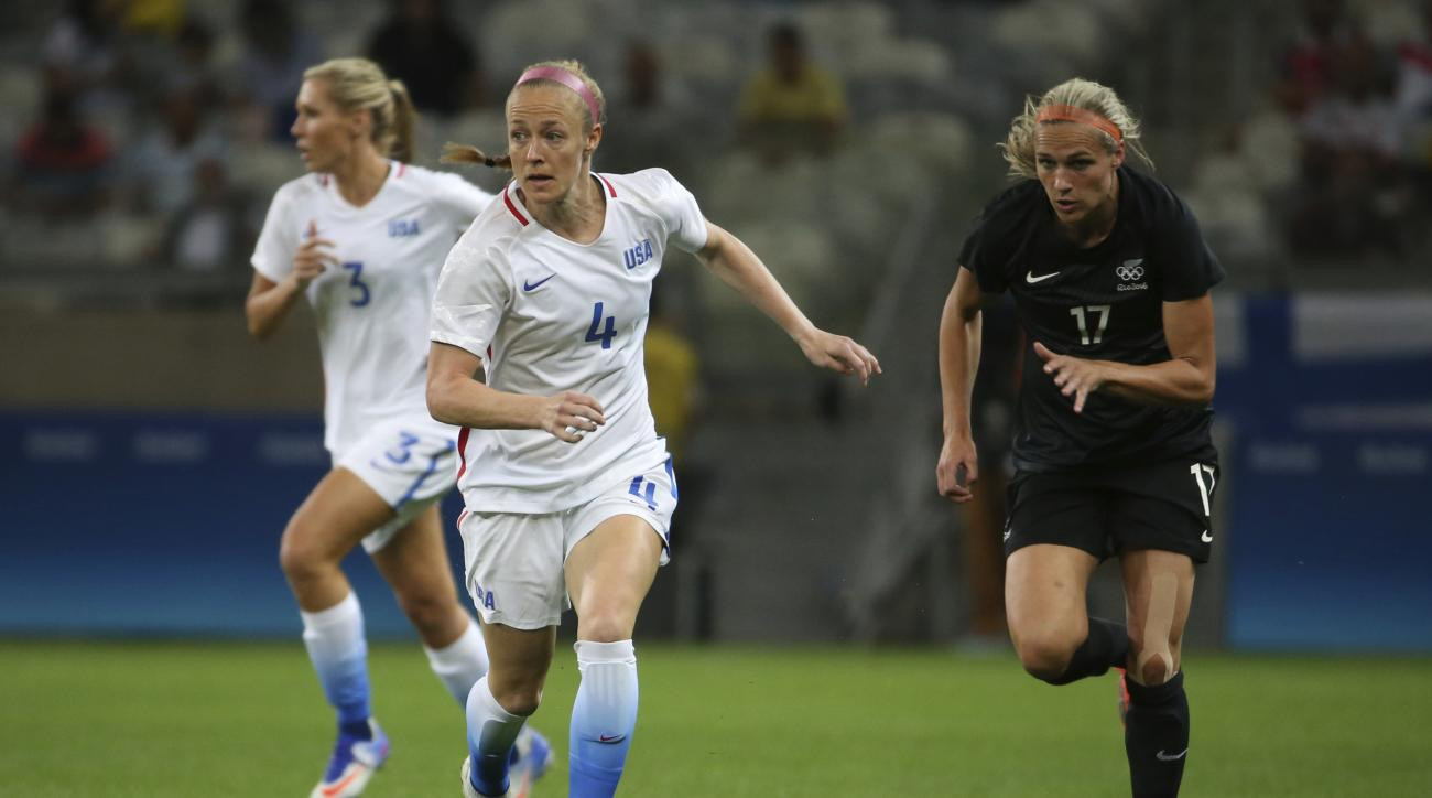 FILE - In this Aug. 3, 2016 file photo, United States' Becky Sauerbrunn, left, dribbles the ball past New Zealand's Hannah Wilkinson, right, during a women's Olympic football tournament match at the Mineirao stadium in Belo Horizonte, Brazil.  An emphasis