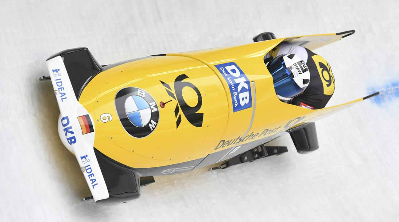Germany's Francesco Friedrich and Thorsten Margis speed down the track during the first run of the men's two-man bobsled World Cup race in Igls, near Innsbruck, Austria, Saturday, Feb. 4, 2017. (AP Photo/Kerstin Joensson)