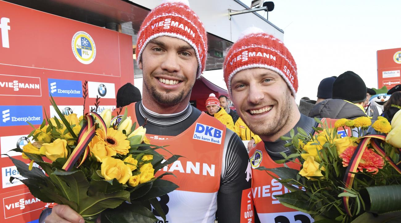 Germany's Tobias Wendl, left, and Tobias Arlt celebrate after they won the men's doubles event of the Luge World Cup in Oberhof, Germany, Saturday, Feb. 4, 2017. (Martin Schutt/dpa via AP)