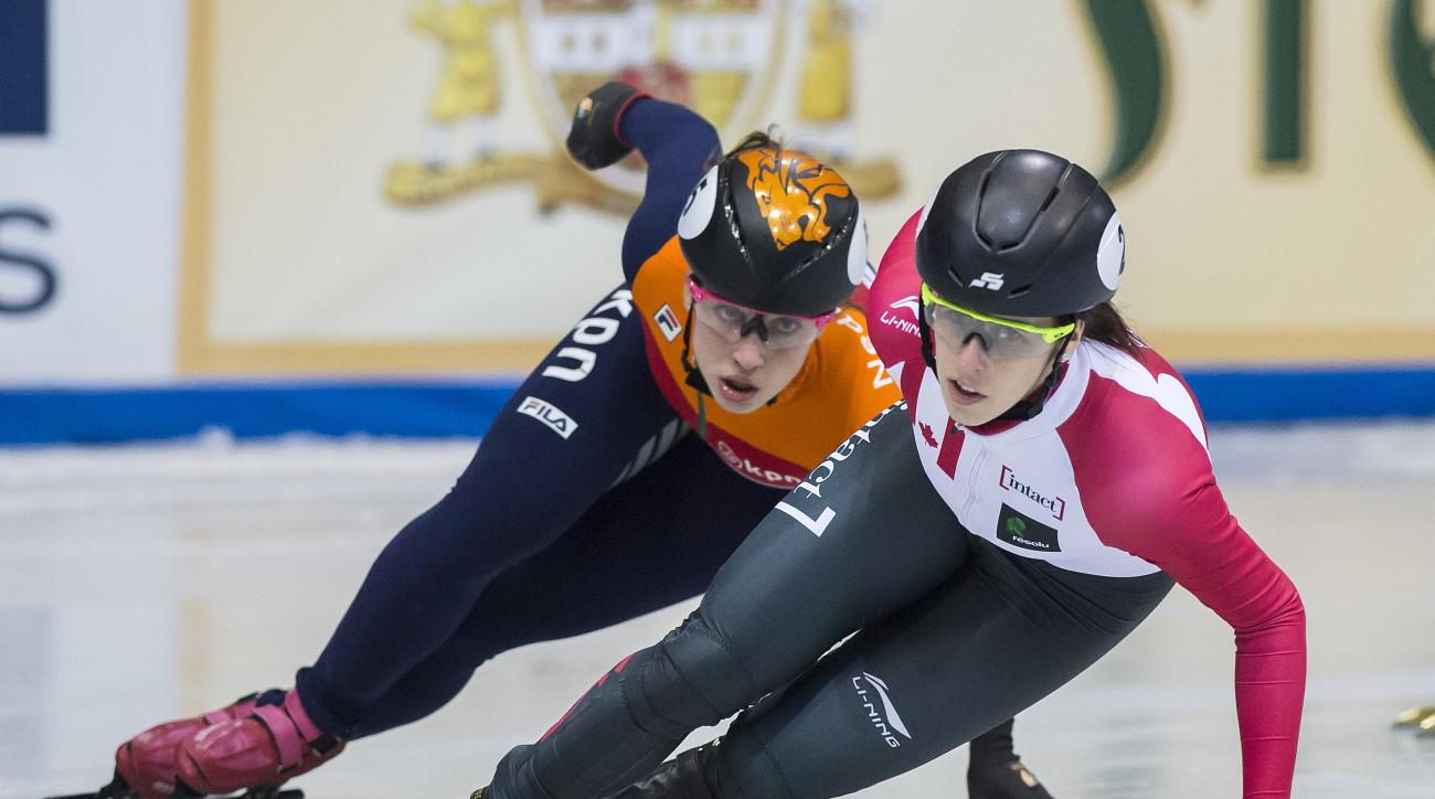 Winner Marianne St-Gelais of Canada, right, skates in front of second placed Suzanne Schulting of Netherlands, left, during the women's 1,000 meters final race at the  short track speed skating World Cup in Dresden, eastern Germany, Saturday, Feb. 4, 2017