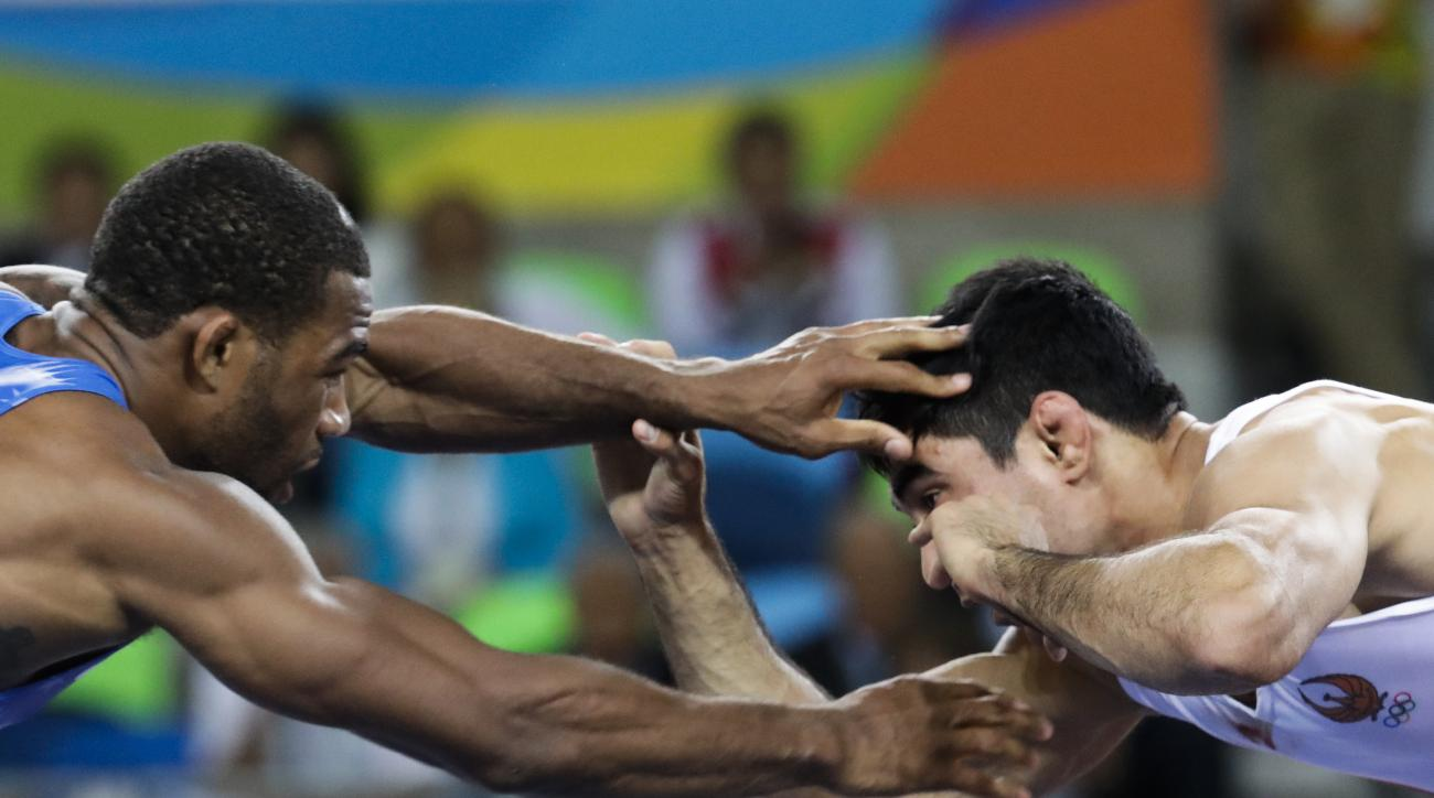FILE - In this Aug. 19, 2016, file photo, United States' Jordan Ernest Burroughs, left, competes against Uzbekistan's Bekzod Abdurakhmonov during the men's 74-kg freestyle wrestling competition at the 2016 Summer Olympics in Rio de Janeiro, Brazil. Iran h