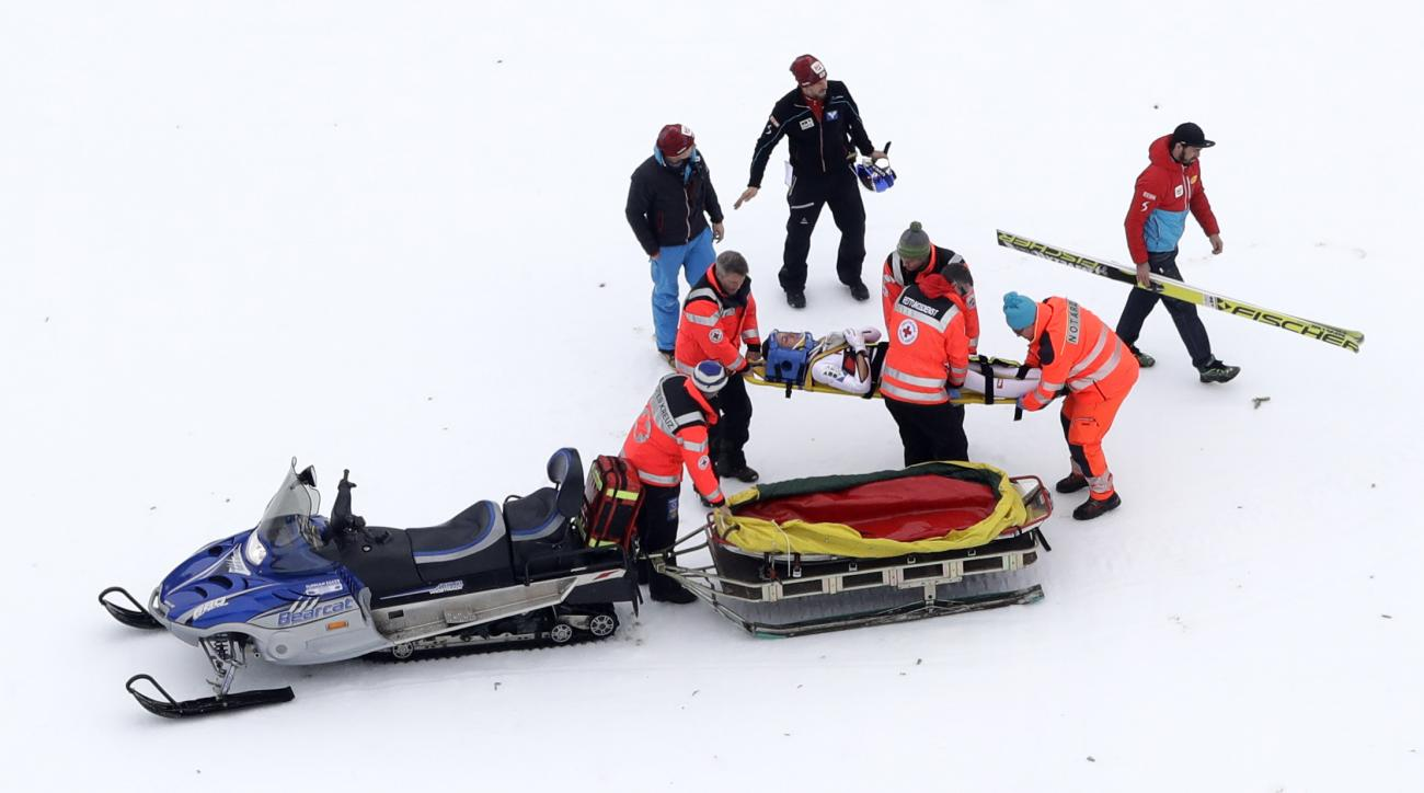 Austria's Gregor Schlierenzauer lies on a stretcher after he crashed during the Ski Flying World Cup in Oberstdorf, Germany, Sunday, Feb. 5, 2017. (AP Photo/Matthias Schrader)