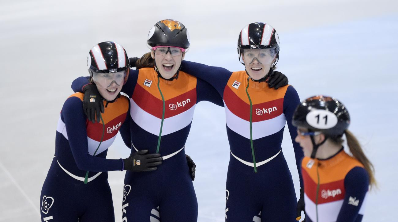 The Netherlands' team celebrate their victory during the women's  3,000 meters relay final race at the World Cup short track speed skating championship in Dresden, eastern Germany, Sunday, Feb. 5, 2017. (AP Photo/Jens Meyer)