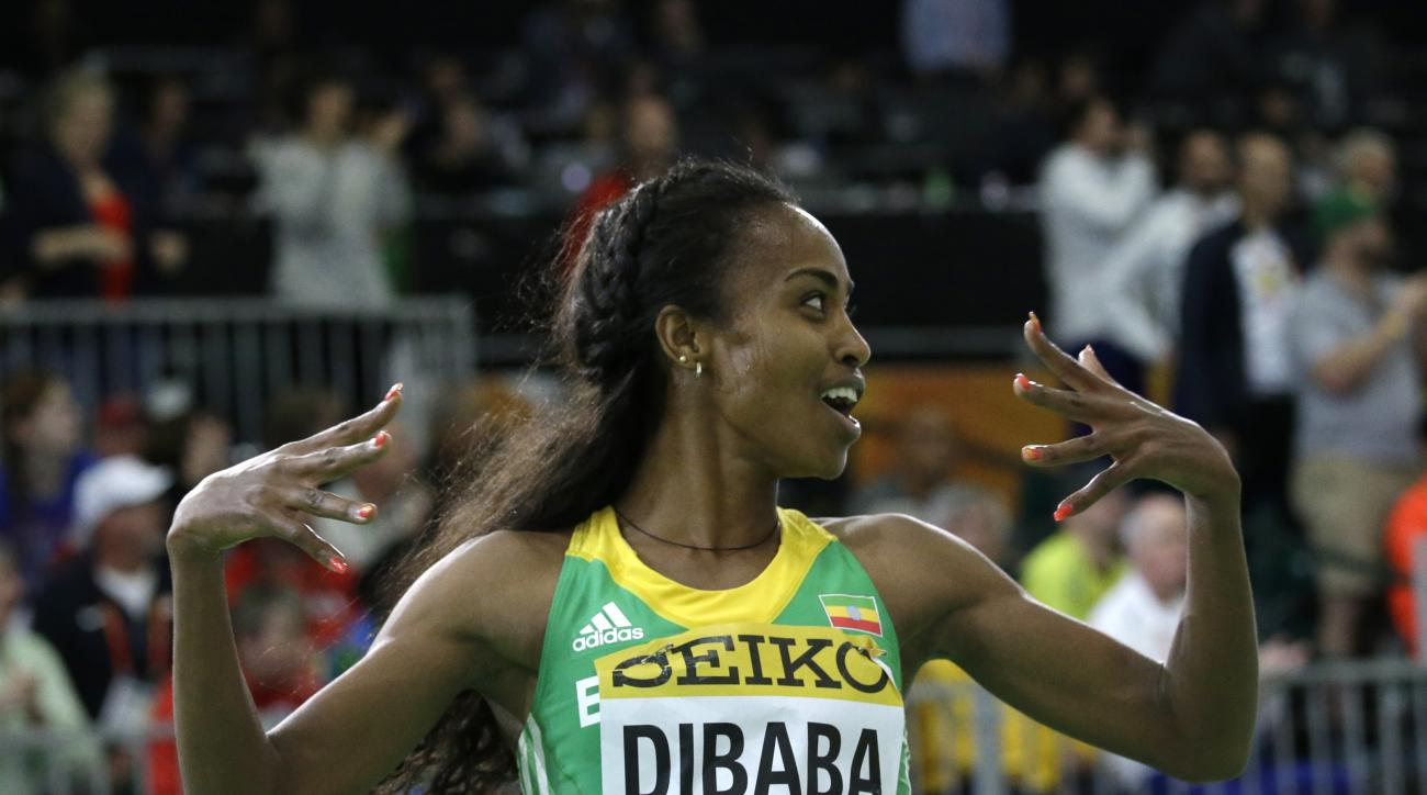 FILE- In this Sunday, March 20, 2016 file photo, Ethiopia's Genzebe Dibaba reacts after she won the women's 3000-meter run final during the World Indoor Athletics Championships in Portland, Ore. Dibaba broke the women's 2,000-meter world record at the ind