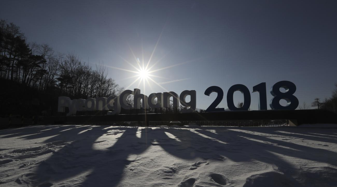 In this Friday, Feb. 3, 2017 photo, a sign of the 2018 Pyeongchang Olympic Winter Games is seen in Pyeongchang, South Korea. One year before the Olympics, the country is in political disarray, and winter sports are the last thing on many peoples minds. To