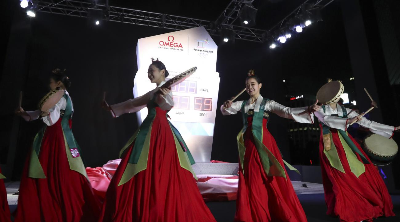 Dancers in traditional costumes perform during the unveiling ceremony of the countdown clock for the 2018 Pyeongchang Winter Olympics in Seoul, South Korea, Wednesday, Feb. 8, 2017. Pyeongchang is the host city of the 2018 Olympic and Paralympic Winter Ga