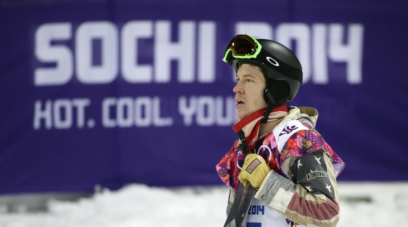 FILE - In this Feb. 11, 2014, file photo, Shaun White, of the United States, looks at the scoreboard after competing in the men's snowboard halfpipe final at the Rosa Khutor Extreme Park, at the 2014 Winter Olympics in Krasnaya Polyana, Russia. The next O