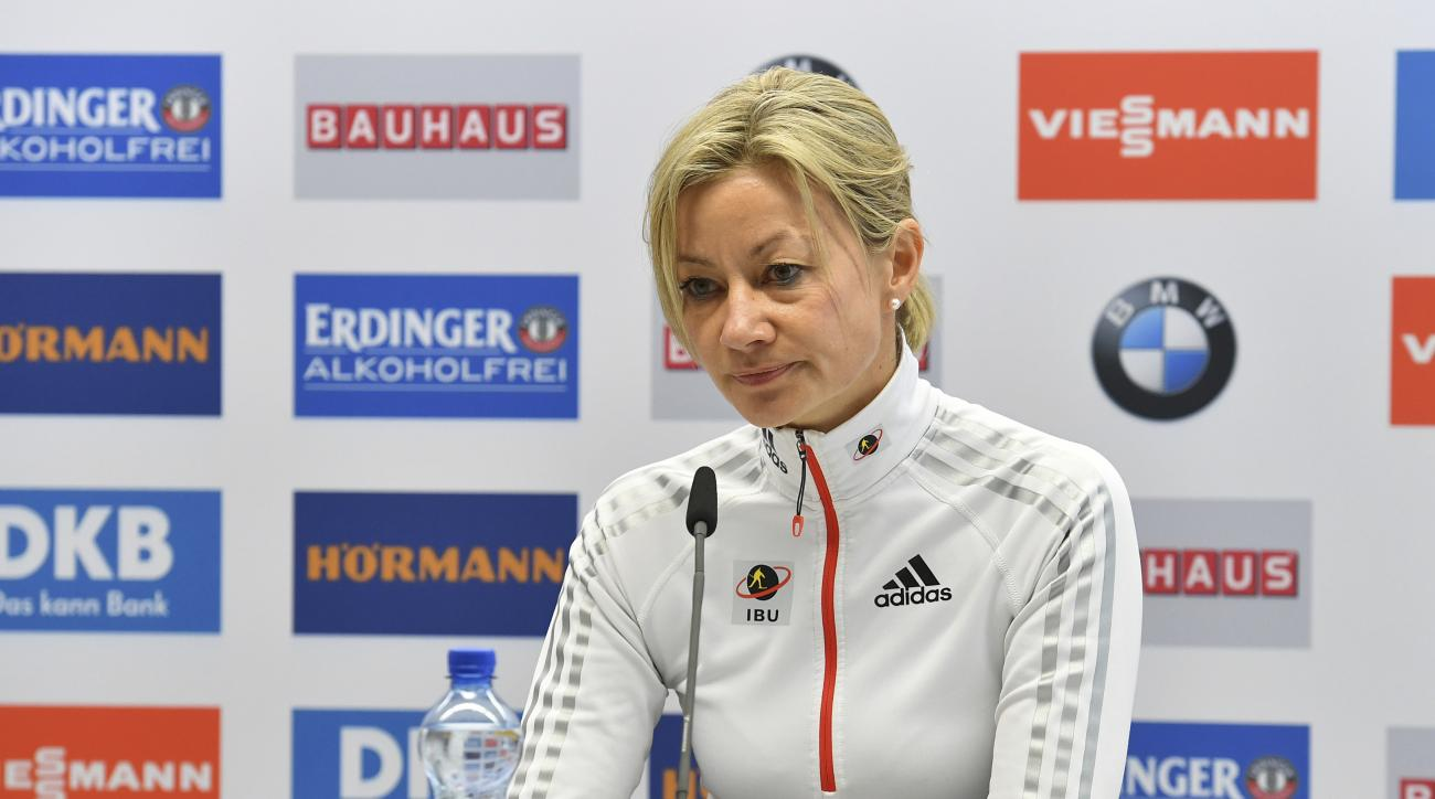 Nicole Resch, secretary general of the International Biathlon Union, speaks  during a  news conference at the biathlon World Championships in Hochfilzen,  Austria, Thursday, Feb. 9, 2017. Austrian police searched  the rooms of the Kazakhstan  biathlon tea