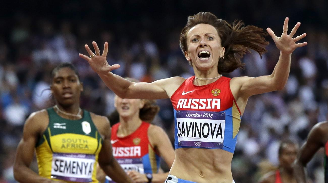 FILE - In this Aug. 11, 2012 file photo Russia's Mariya Savinova, right, reacts as she crosses the finish line ahead of South Africa's Caster Semenya to win the women's 800-meter final during the athletics in the Olympic Stadium at the 2012 Summer Olympic
