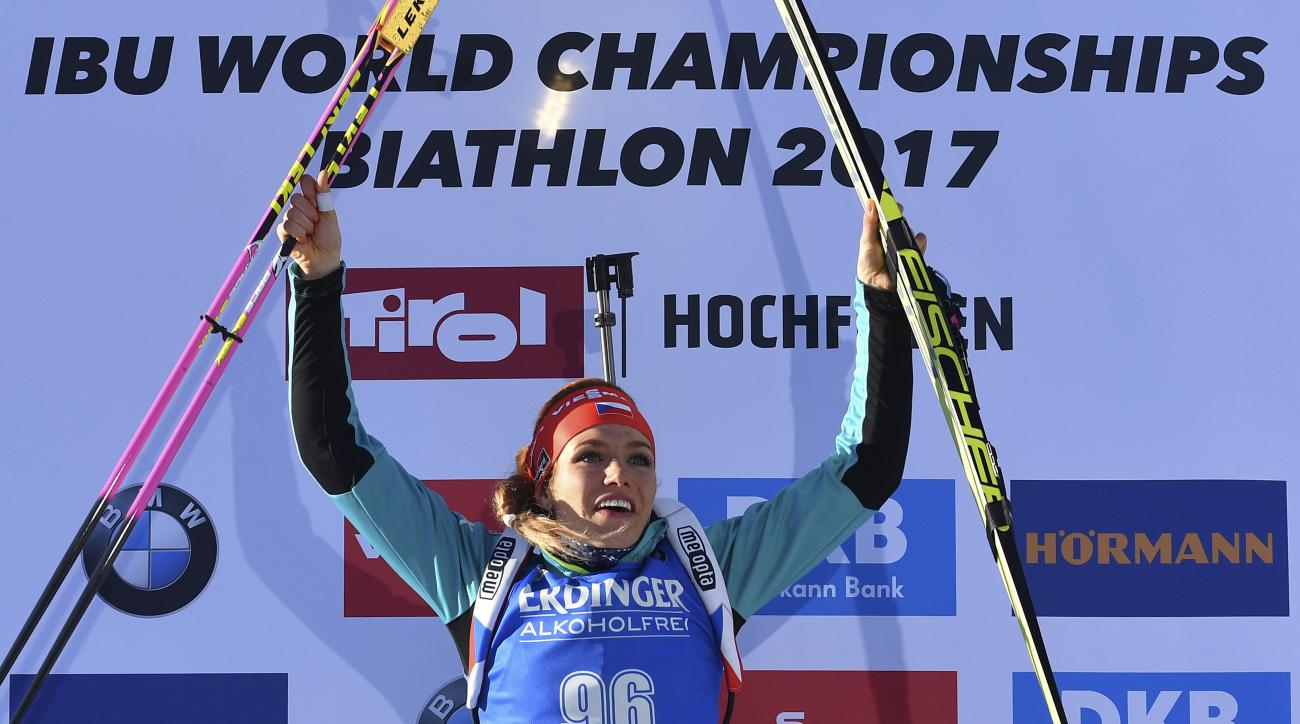 Czech Republic's winner Gabriela Koukalova celebrates on the podium after the women's 7.5 km sprint competition at the Biathlon World Championships in Hochfilzen,  Austria, Friday, Feb. 10, 2017. (AP Photo/Kerstin Joensson)