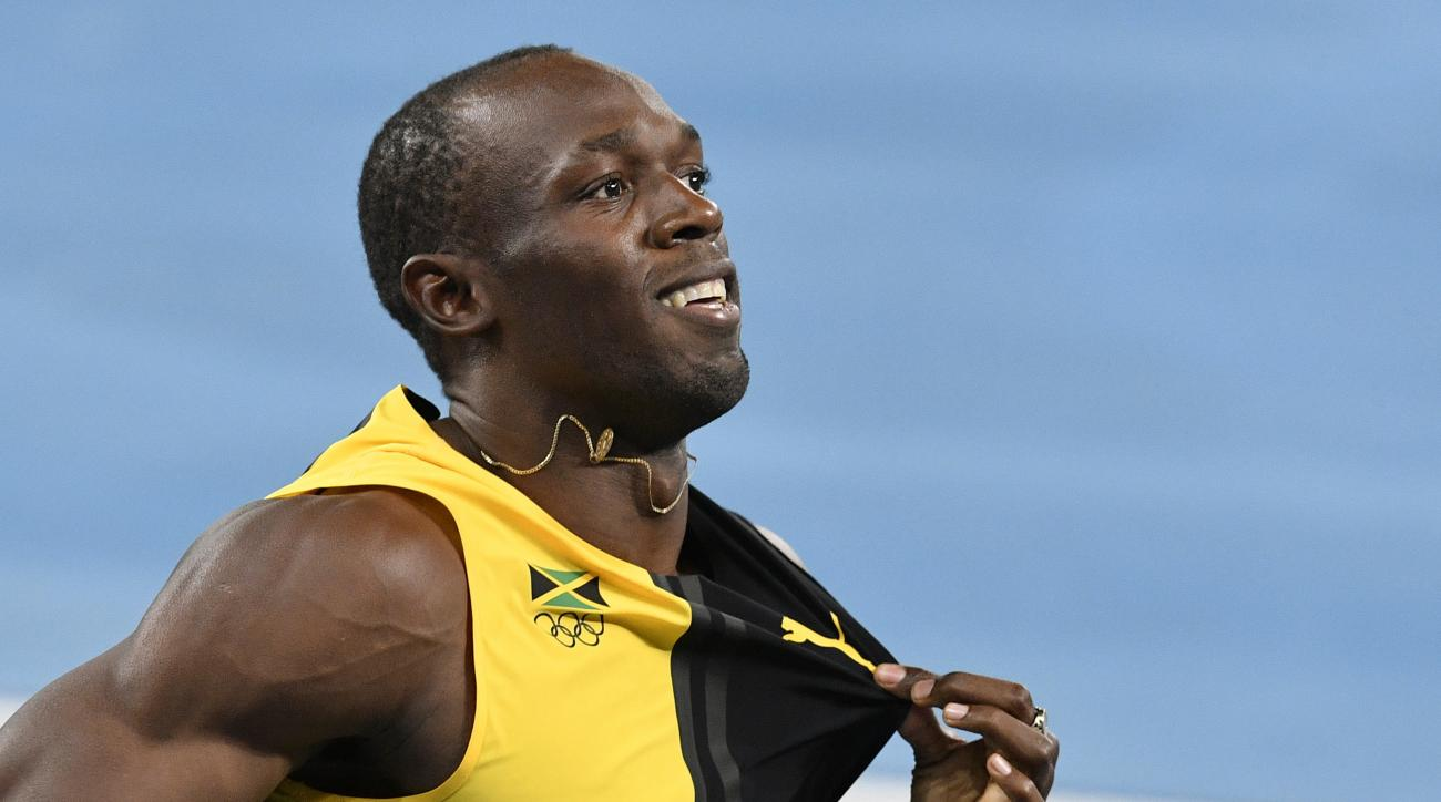 FILE - In this Aug. 19, 2016 file photo, Jamaica's Usain Bolt celebrates winning the gold medal in the men's 4x100-meter relay final during the athletics competitions of the 2016 Summer Olympics at the Olympic stadium in Rio de Janeiro, Brazil. Bolt and h