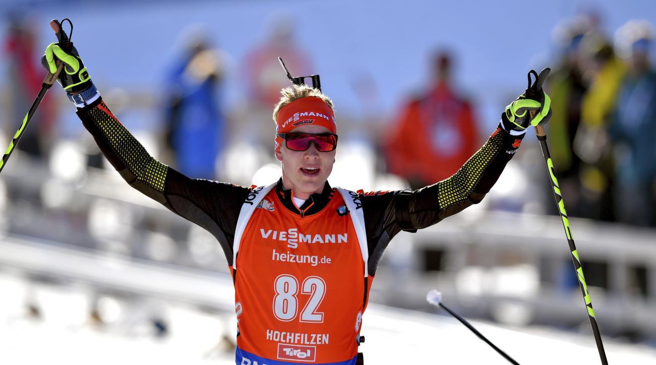 Germany's winner Benedikt Doll celebrates after the men's 10 km sprint competition at the Biathlon World Championships in Hochfilzen, Austrian province of Tyrol , Austria, Saturday, Feb. 11, 2017. (AP Photo/Kerstin Joensson)